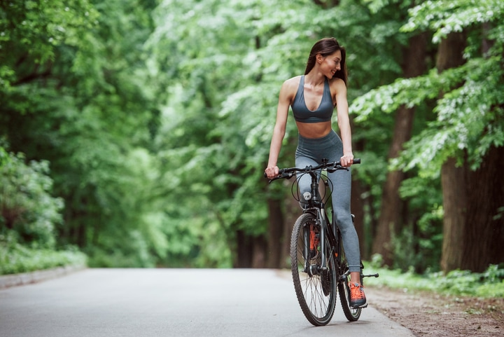 girl riding a bike a stay fit